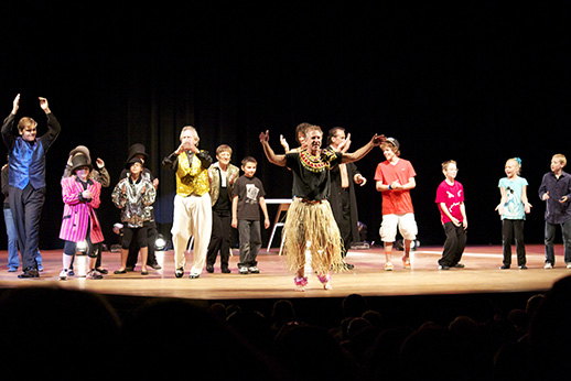 Eddie Goldstein grass skirt Magic in the Rockies Kids Show Finale on stage at Lincoln Center in Ft. Collins